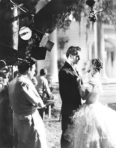 Director William Wyler watches Bette Davis and Henry Fonda perform a scene for the film Jezebel, 1938