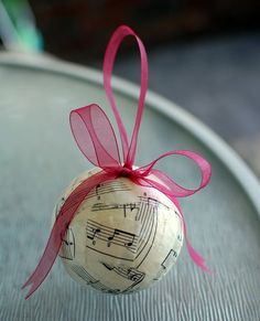 sheet music ornament--for piano teacher? Good use for old ornaments.