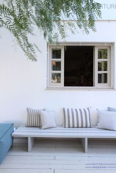 Custom fabrics and pillows-with reclaimed wood painted bench. Modern simple and inviting  ::  tanisibiza.com