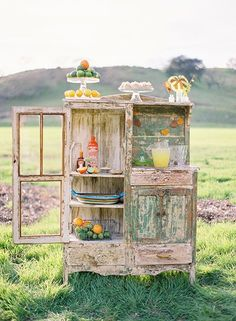 weathered hutch used outdoors. to serve drinks for a party? so cute