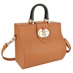Medici-Whisky-Brown-by-OYSBY Sophisticated trunk design made of sleek smooth Vacchetta leather, finished with the signature OYSBY lipstick clasp closure.  This bag is versatile, elegant and practical. Perfect for both daytime appointments and evening adventures