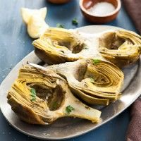 Oven Braised Artichokes with Garlic and Thyme from @Sylvie   Gourmande in the Kitchen.  Love artichokes, and love her styling.