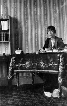 Katherine Mansfield (who died at 34 from adrenal insufficiency) having tea at her work table, at the Villa Isola Bella at Menton, in the south of France. (Photograph by Ida Baker, Katherine Mansfield, Best Short Stories, Critical Essay, Bloomsbury Group, English Writers, Pose, Writers And Poets, People Of Interest, Book Writer