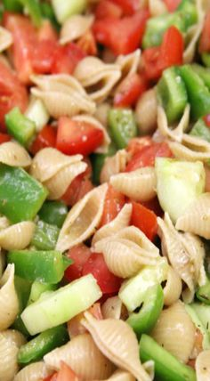 Shell pasta with tomatoes, cucumber, and green pepper in a Greek vinaigrette. Tip: Add mince red onion or chopped green onion too.
