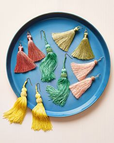 13 Beautiful Earrings You Can Make Yourself | Martha Stewart - Look at you, trendsetter! Here's how to make earrings using beads, tassels, charms, and lightweight stones. #handmadejewelry #diyjewelry
