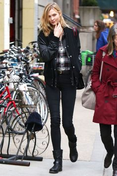 Model Karlie Kloss hits the New York streets with a cool bomber jacket, skinny jeans and Rag & Bone boots.   - HarpersBAZAAR.com