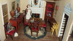 Tynietoy dining room with two wooden knife boxes on the bow front sideboard.  littlethingsloved