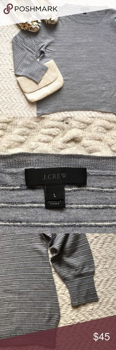 J. Crew wool quarter sleeve tee Light gray 3/4 sleeve top with skinny white and navy blue stripes by J. Crew. Perfect condition! SO SOFT! Made of 100% merino wool. Size large. (J. Crew metallic flats also for sale in a separate listing) J. Crew Tops Blouses