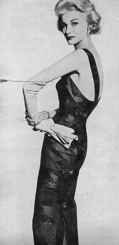 Sunny Harnett in a slim evening sheath, Vogue 1957
