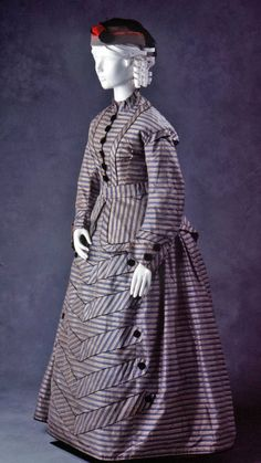 Very ingenious use of stripes (which are seen often in the Bustle Era). silk taffeta day dress from Powerhouse Museum. Vintage Outfits, Vintage Gowns, Vintage Mode, 1870s Fashion, Victorian Fashion, Vintage Fashion, Victorian Era, Historical Costume, Historical Clothing