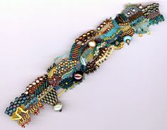 * Julie's Freeform Bracelet - 2 free pdf instructions. Be sure to look at the 2nd one. #seed #bead #tutorial