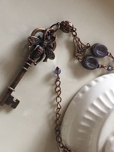 A personal favorite from my Etsy shop https://www.etsy.com/listing/603253927/vintage-key-charm-purple-necklace-bee