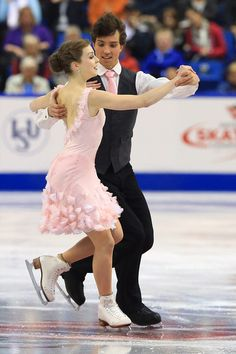 Alexandra Paul and Mitchell Islam of Canada skate during the ice dance short program  2013 Skate Canada,  Ice Dancing dress inspiration for Sk8 Gr8 Designs.