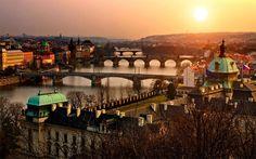 As the sun sets over Prague