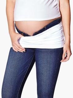 Extend your wardrobe throughout your pregnancy thanks to this simple and discreet maternity belly band! <br /><br />- Silicon strip<br />- Super stretchy fabric<br />- At the beginning of pregnancy: wear it folded over to hold up unbuttoned pre-pregnancy pants and jeans <br />- During pregnancy: wear it full panel to hold up your maternity pants and jeans<br />- With baby: wear it to transition to regular clothing and get extr...