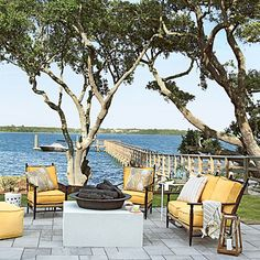 Tour the Outdoor Spaces at the Daniel Island Showhouse From the front porch to the back patio, our d Outdoor Rooms, Outdoor Gardens, Outdoor Living, Outdoor Decor, Outdoor Ideas, Backyard Retreat, Backyard Landscaping, Yellow Outdoor Furniture, Wicker Furniture