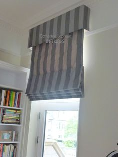 Ideas for dressing a tall narrow window.  Handmade grey striped silk roman blind with box pelmet to match by Edinburgh curtainmaker Catherine Lepreux Interiors #tradtitionalwindow #romanblind #sashindow