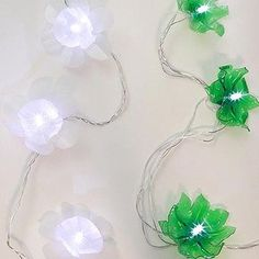 recycle your plastic bottles into sweet little flower surrounds for your christmas lights this year.
