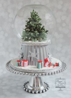 Christmas Snow Globe - The evergreen tree is made from gum paste. Each branch is individual. The base is made from using the large cupcake pan, and the gifts are made from modeling chocolate.