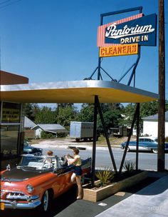 "June 1956. ""Aspects of life in Southern California, including cars at drive-in restaurant, drive-in laundromat, drive-up bank, shopping center."" Kodachrome by Maurice Terrell for the Look magazine assignment ""Los Angeles: The Art of Living Bumper-to-Bumper."""