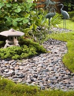 Stock Photo Titled: A Backyard Japanese Garden With A Dry Stream Bed,  Lantern And Crane Statuary, Unlicensed Use Prohibited Part 95