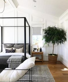 Cool California vibes achieved by white walls, neutral tones and of course, a healthy house plant! Design by Amber Interiors. White Bedroom With Plants Home Decor Bedroom, Master Bedroom, Bedroom Ideas, Bedroom Colors, Bedroom Wall, Bedroom Designs, Master Suite, Bedroom Furniture, Decoration Inspiration
