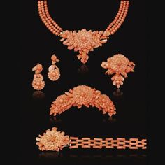 Carved coral parure (necklace, earrings, brooch, bracelet, and hair ornament), c. 1850.