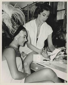 """Black and white image of Valda Boyne Esau (left) and Enid Mills (right, line captain) at the first Lido show at the Stardust Hotel in Las Vegas, 1958.  Image is part of UNLV Libraries """"Photo"""" digital collection."""
