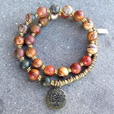 27 bead mala bracelet, made with genuine picasso jasper, hand made brass African Trade Beads (for sizing) and a tree of life charm. It wraps as a bracelet, (stringed on thick hi-tec elastic). Great on