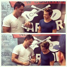 lol it looks like he's showing Hunter his biceps XD