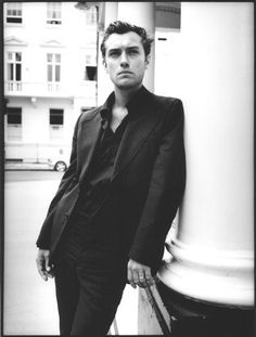 Jude Law 2|Jude Law 2|man|actor|black and white|leaning| street|pillar|suit|pinstripe|shirt|serious|B&W