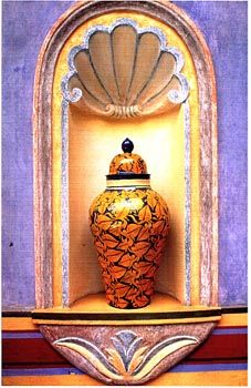 Mexican niche, Mexican pottery. La Fuente Imports offers similar Talavera jars & vases here: http://www.lafuente.com/Mexican-Decor/Talavera-Pottery/Jars-and-Vases/