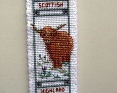 Cross Stitched Aberdeen Angus/Highland Cow Bookmark.