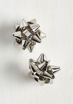 Catch My Gift? Earrings. If anyone in your life missed the memo that every day is one worth celebrating, these silver stud earrings will get em up to speed! #silver #modcloth