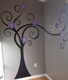 Painted black, swirly tree with purple flowers and name.  Size is negotiable based upon wall space.  $160