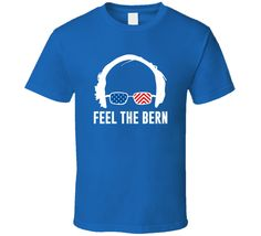 "This Feel The Bern Bernie Sanders 2016 Support Election T Shirt is one of our favorites, it wont be around forever so order yours here today! The graphic is printed on a quality, preshrunk cotton t shirt you will love, satisfaction guaranteed. It would make a great addition to your wardrobe, or buy it as a gift for friends and family. <br><br><FONT COLOR = ""Black""><h3>DON'T FORGET ABOUT OUR $4.95 FLAT RATE SHIPPING ON TEES! </font></h><br> <h3><b><FONT COLOR = ""Black"">If you like this shirt…"