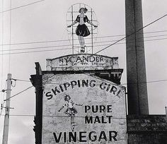 "The Skipping Girl neon sign, photographed  in 1968. ""Little Audrey"", Abbotsford, Melbourne, Australia. Via The Age. Erected in 1937, the locally iconic advertising sign for Skipping Girl Vinegar, achieved official state heritage registration in 2007."