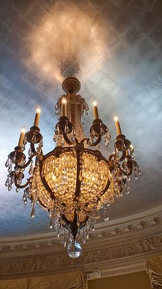 This chandelier designed by Oregon artisan Fred Baker is reflected by the silver leaf ceiling in the Music Room