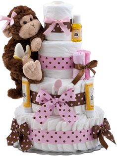 Need a Baby Gift?  Whether a baby shower or a gift to send, you can delight the new mom with something unique and different.  All mom's need diapers so why not send a bundle of them arranged as a traditional tiered cake?  Of course, nothing to eat here, just an adorable arrangement of Pampers Brand Diapers decorated with pink and brown dotted ribbons.  A Gund Brand monkey sits on the side and then Burts Bees baby care products are added to complete the design.  Shop our entire collection.