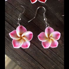 CUTE Pink Hawaiian flower earrings These cute earrings are perfect for spring and summer! The flowers are clay and the hooks are silver plated. They are roughly the size of a penny. Jewelry Earrings