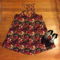 Roses! Roses! Roses!  Flowy rose printed dress. Open cage back. Perfect for a beach cover up or a hot summer day. Forever 21 Dresses Mini
