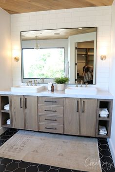 Utah Valley Parade of Homes 2019 I like the cabinet color and style with the open shelves. Like the ceiling treatment and the large mirror with metal edges. Don't like the above counter sinks Eclectic Bathroom, Modern Master Bathroom, Bathroom Interior, Master Bathrooms, Master Bedroom, Bathroom Grey, White Bathrooms, Luxury Bathrooms, Minimalist Bathroom
