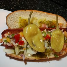 Philadelphia Phillies Chicago Dog...Why It's a Hit: A mountain of toppings. Phillies fans are taking a tip from their Midwest neighbors. The stadium may be in Philadelphia, but its signature item is the Chicago Dog, a classic ballpark treat done in true Windy City style. It's topped with sweet green relish, hot peppers, and diced onions and tomatoes, and all served on a poppyseed bun.... - #hot #dog #dogs #recipes