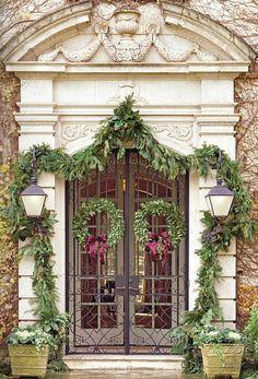 holiday door (via The Enchanted Home: Wishing you a Merry Christmas) Christmas Front Doors, Christmas Porch, Noel Christmas, Outdoor Christmas, Christmas Decorations, Christmas Garlands, Christmas Greenery, Xmas, Southern Christmas