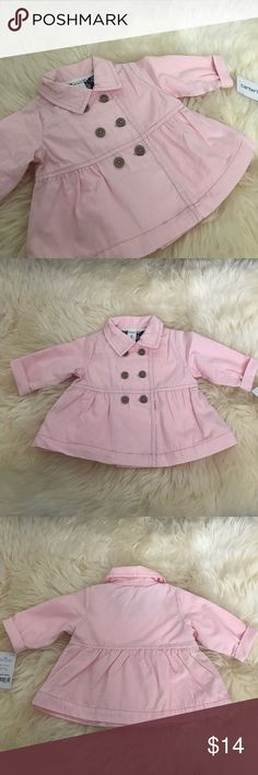 BABY Pink Peacoat Cute and classic, this peacoat features a floral jersey lining to take her into spring with style. Button-front design. Soft, lightweight canvas. Stitched babydoll waist. Full jersey lining. Never worn. Excellent condition. Carter's Jackets & Coats Pea Coats