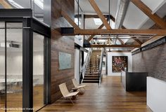 Natural and Rustic Interior of a Creative Agency barn wood surrounds conference room5
