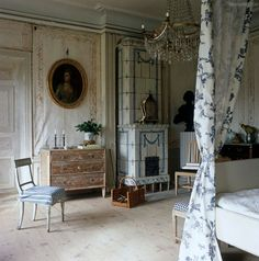 The Large Master Bedroom Has Walls Covered In Linen Canvas Panels And A Neoclassical Tiled Stove BM
