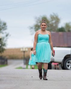 David's Bridal bridesmaids in a short strapless lace and mesh teal blue bridesmaids dress for a country wedding from David's Bridal | Photo Premier Films Photography