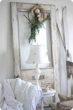 love this look of vintage door on wall - white on white so sweet