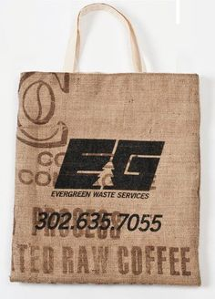 """Espresso Recycled Jute/Burlap Coffee Tote  * Recycled burlap Jute coffee bag  * Flat construction  * Natural canvas lining  * Reversible design  * 3/4"""" Natural cotton self handles  * Overall dimensions 14.5 x 16""""h  * Includes 1 color imprint  * Text must be min. 3/8"""" high  * Imprint area 10 x 10""""h  * Made in USA"""